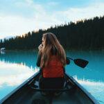blonde woman boating on lake