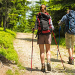 couple hiking on forest trail