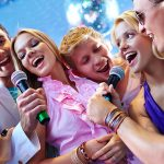 friends singing at party