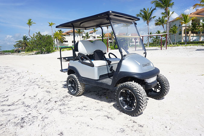 golf cart on sand beach