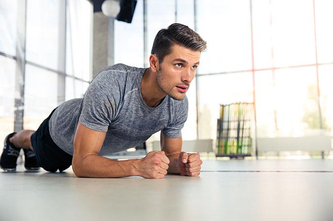 man doing planking exercise