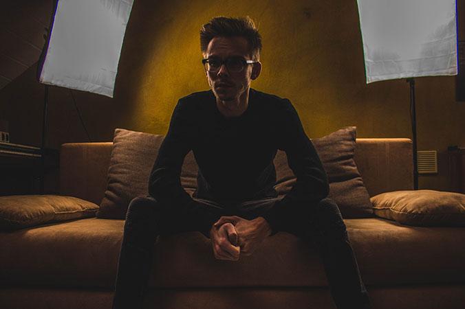 man on sofa dark room